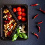 Healthy food and diet concept. Dietary catering. Restaurant dish delivery. Fitness meal. Take away. Fit and eat. Weight loss nutrition in foil boxes. Healthy salad with beetroot. Wholemeal pasta. Mozzarella, cherry tomato, basilica.